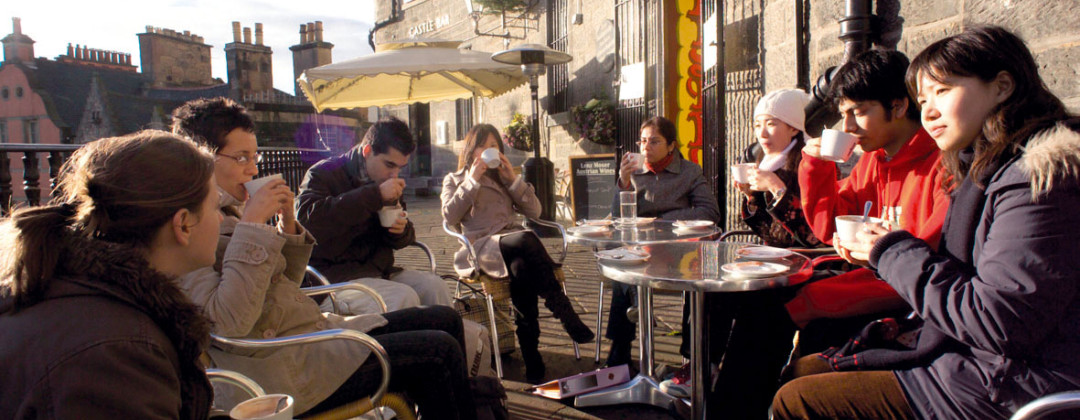 Students drinking coffee on Edinburgh's Victoria Street